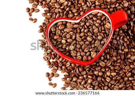 Heart shaped coffee mug dived in coffee beans, Valentines day. Horizontal, isolated, with copy space. - stock photo