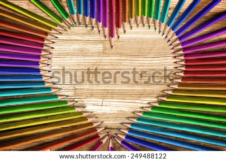 Heart shaped coloured pencils - stock photo