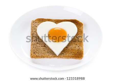 heart shaped cooked egg on toast isolated on white background