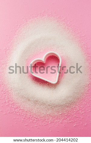 Heart shaped cookie cutter with sugar - stock photo