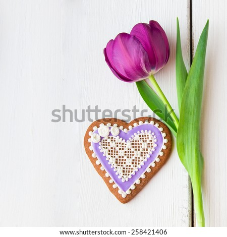 Heart shaped cookie decorated with ornaments and flowers for Valentines day. - stock photo