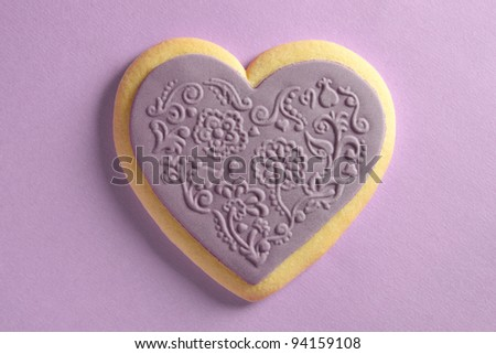 Heart shaped cookie with ornaments - stock photo