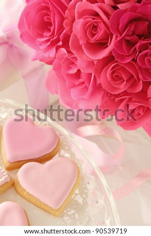 Heart shaped cookies and roses bouquet  for valentine's day - stock photo