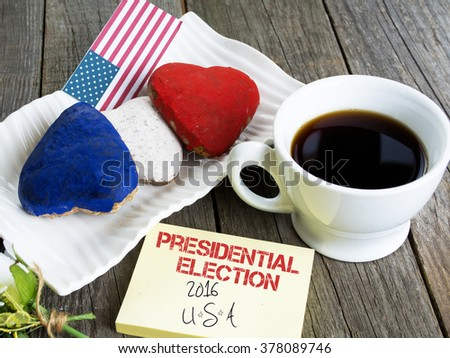 Heart shaped cookies color red, blue, white. Cup of coffee (tea), USA flag, decoration on old wooden table. Patriotic Breakfast Concept - 2016 USA presidential election - stock photo