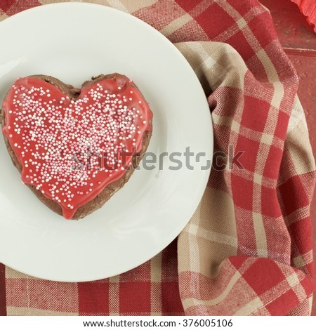 Heart shaped cookies decorated with red sugar glaze and sprinkles. Top view