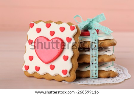 Heart shaped cookies for valentines day on color wooden background - stock photo