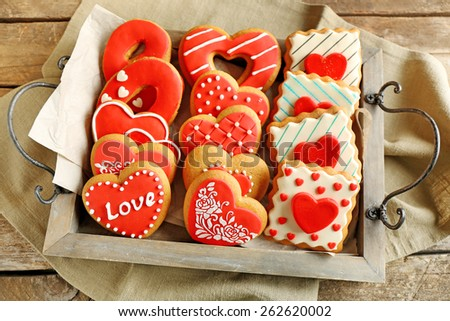 Heart shaped cookies for valentines day on tray, on wooden background - stock photo