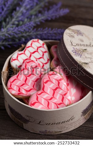 Heart shaped cookies with icing and lavender in provence style box on wooden background - stock photo