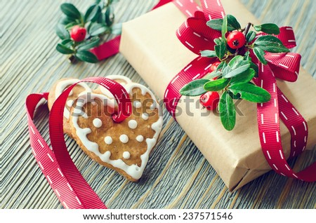 Heart shaped cookies with icing decoration and a present box - stock photo