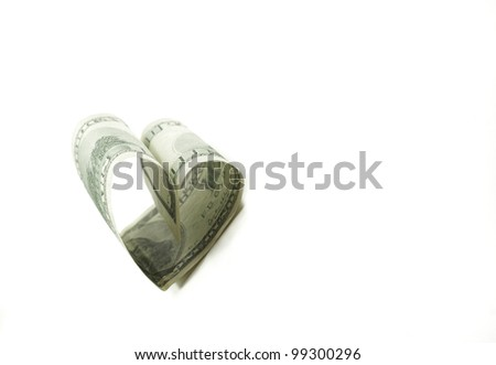 heart shaped 100 dollar bill isolated on white background - stock photo