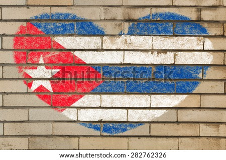 heart shaped flag in colors of Cuba on brick wall - stock photo