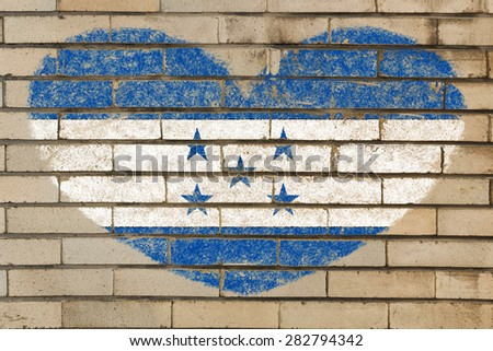 heart shaped flag in colors of honduras on brick wall - stock photo