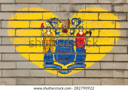 heart shaped flag in colors of new jersey on brick wall - stock photo