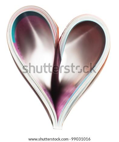 Heart shaped folded magazine isolated over white background - stock photo