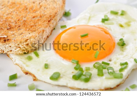 Heart shaped fried in the form of a heart with toast - stock photo