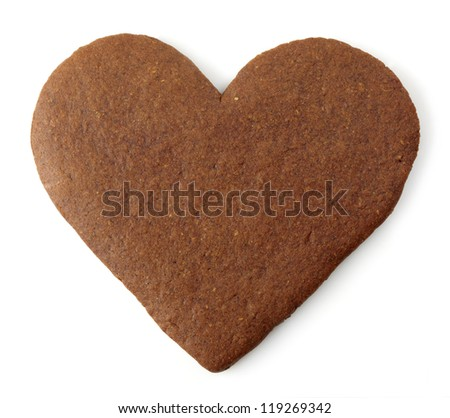 Heart shaped gingerbread cookie on white background - stock photo