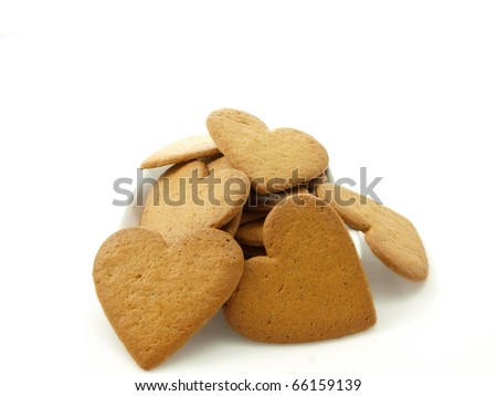 Heart shaped gingerbread, white background - stock photo