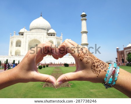 Heart-shaped hands against Taj Mahal. Agra, India - stock photo