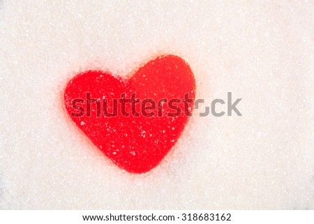 Heart shaped jelly candy in sugar - stock photo