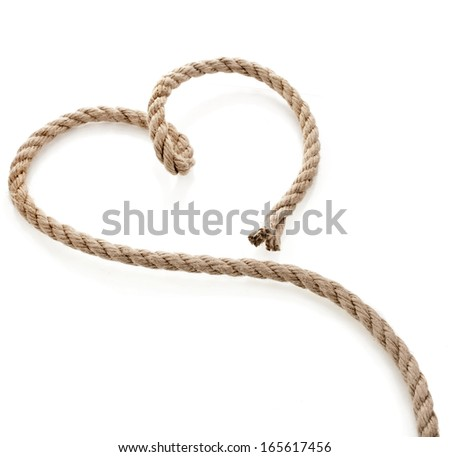 Heart Shaped Knot on a Jute rope isolated on white background - stock photo