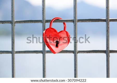Heart shaped love padlock - beautiful wedding day custom. Shallow depth of field - stock photo