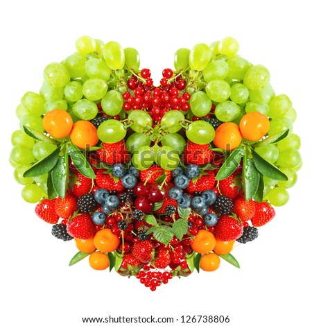 heart shaped mix of fruits and berries isolated on white background - stock photo