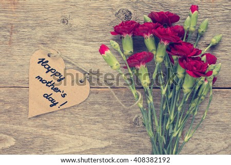 Heart shaped mothers day card with carnations bouquet - stock photo