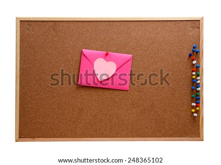 Heart shaped paper notes with envelope pinned into brown corkboard - stock photo