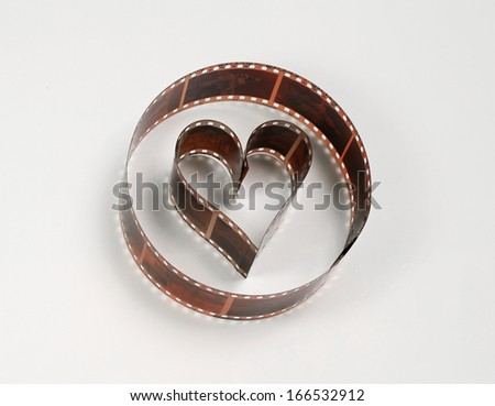Heart shaped photo film, concept of love for photography - stock photo