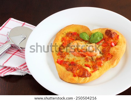 Heart shaped pizza for Valentine's day - stock photo