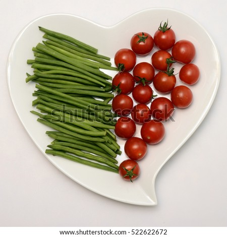 Heart shaped plate and vegetables, healthy food