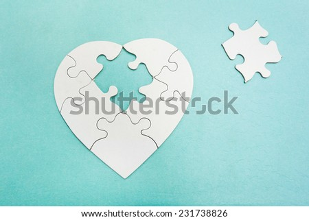 Heart shaped puzzle with missing piece                                - stock photo