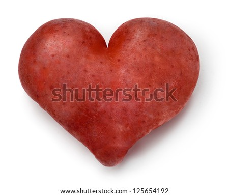 Heart shaped red Potato on a white background. - stock photo