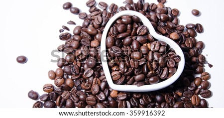 heart shaped roasted coffee beans - stock photo