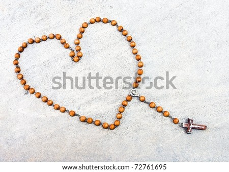 Heart shaped rosary - stock photo