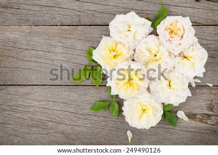Heart shaped rose flowers on wooden table background with copy space - stock photo