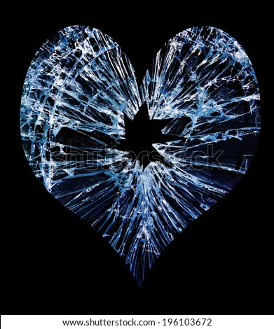 heart shaped shattered glass with a hole in the middle                                - stock photo