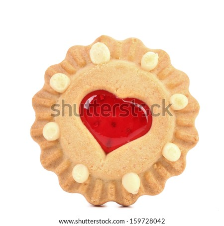 Heart shaped strawberry biscuit close up. Isolated. On a white background - stock photo