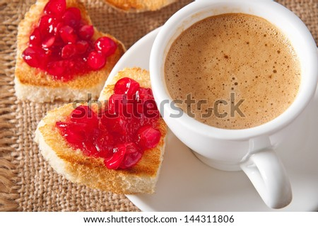 heart-shaped toast with jam and a cup of coffee - stock photo