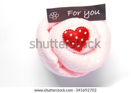 Heart-shaped towel Towel with a heart on a white background. - stock photo