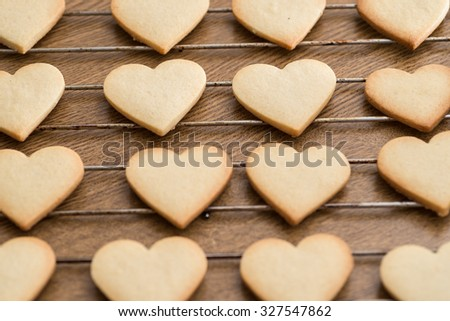 Heart shaped valentine's butter cookies cooling on the rack