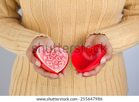 Heart shaped valentine's day cookie in a heart shaped container - valentine's day and healthy lifestyle - stock photo