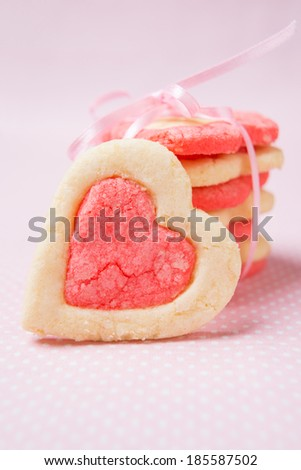 heart shaped vanilla raspberry cookies - stock photo
