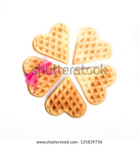 Heart shaped waffles isolated on white background - stock photo