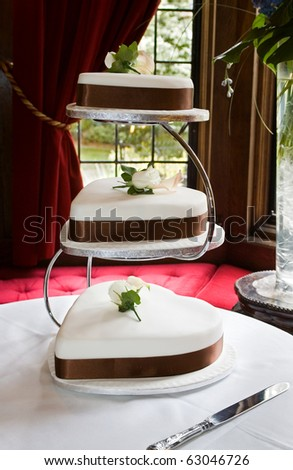 Heart Shaped Wedding Cake's with Brown Sash and Chrome Stand - stock photo
