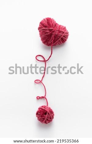Heart shaped woolen yarn - stock photo