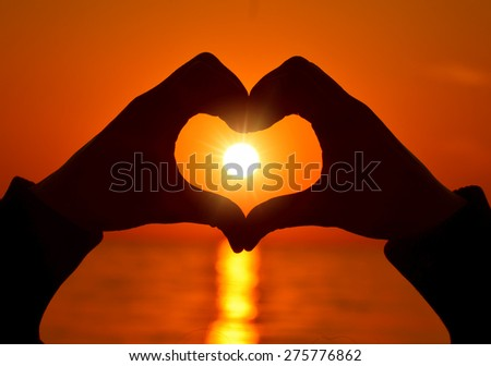 heart shapewith hands  on sunset  - stock photo