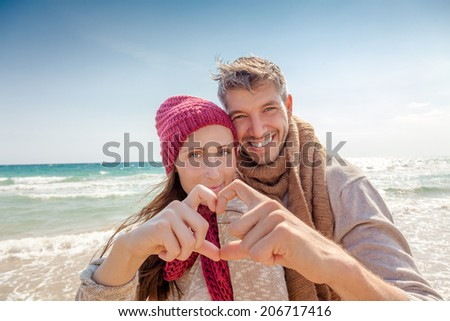 heart showing adults on sunny day - stock photo