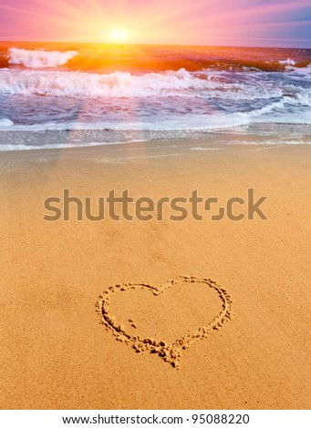 heart sign on sand on sea beach