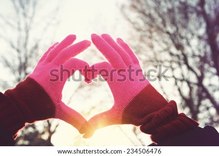 Heart symbol at sunset. Instagram effect - stock photo